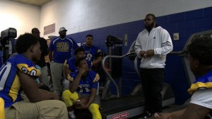 Mark Imgram speaks to Southwestern Academy football team